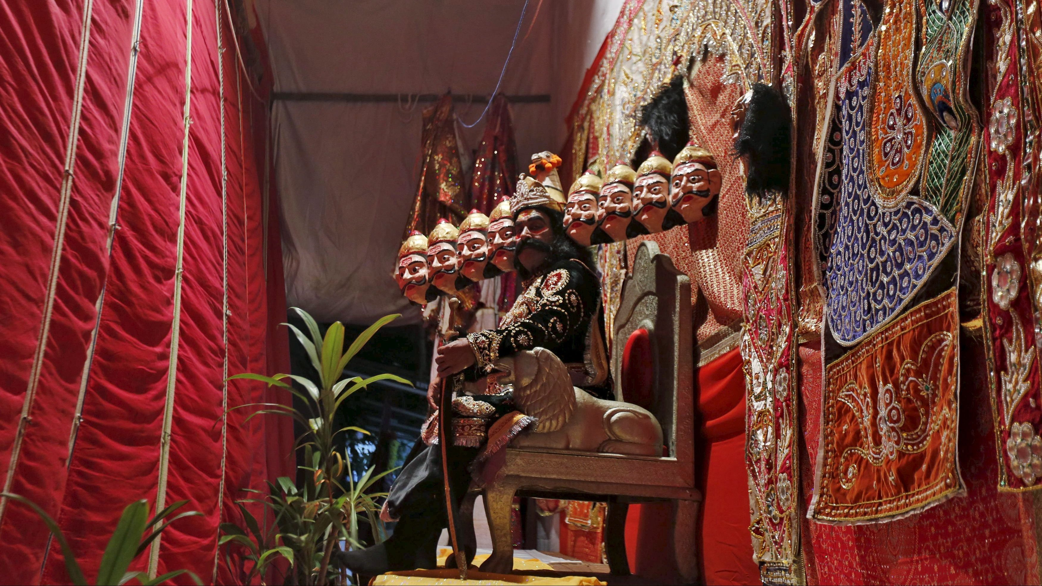 Artist dressed as demon king Ravana waits to performing during Ramlila, a re-enactment of the life of Lord Rama, during Dussehra festival celebrations in Mumbai