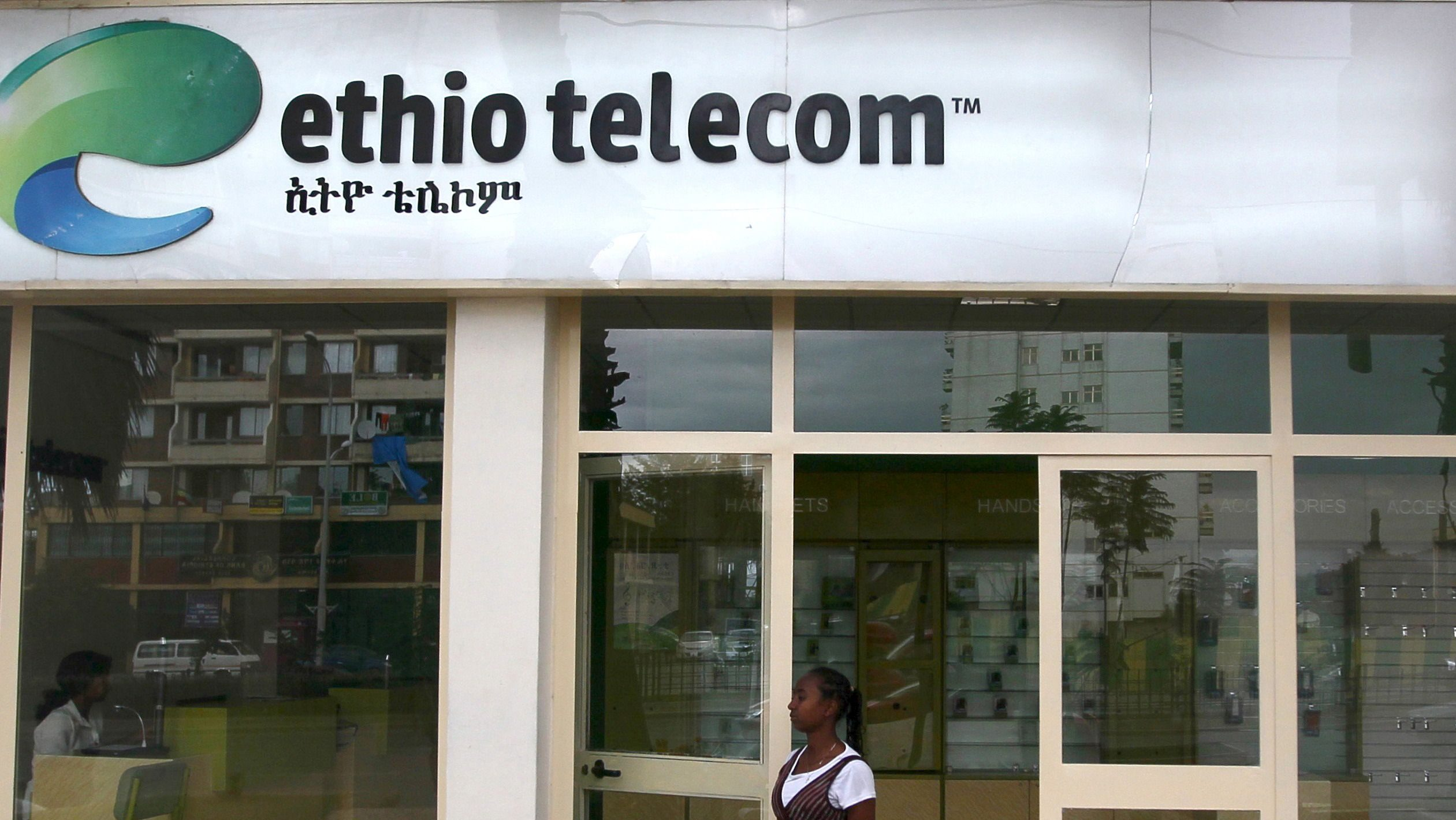 A woman walks past an Ethio Telecom office in Ethiopia's capital, Addis Ababa, November 9, 2015. Ethiopia's state-run telecoms monopoly will launch a tender in December or January to help the company upgrade infrastructure and expand its mobile phone coverage by about 72 percent, the company's chief executive said.