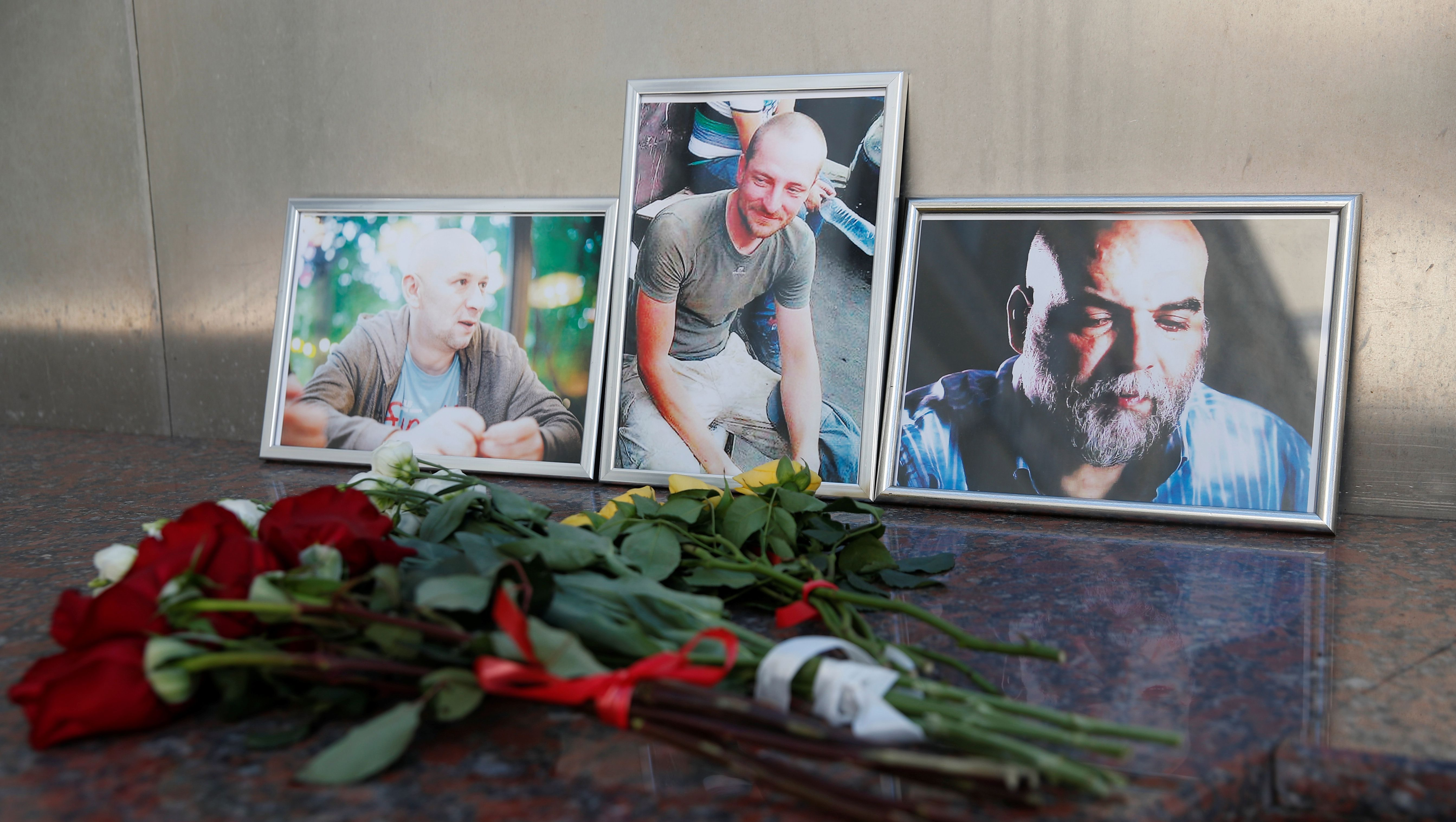 Photographs of journalists, (R-L) Orhan Dzhemal, Kirill Radchenko and Alexander Rastorguyev, who were recently killed in Central African Republic by unidentified assailants, are on display outside the Central House of Journalists in Moscow, Russia August 1, 2018.