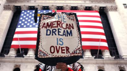 A demonstrator holds a sign during a rally outside Wall Street in New York