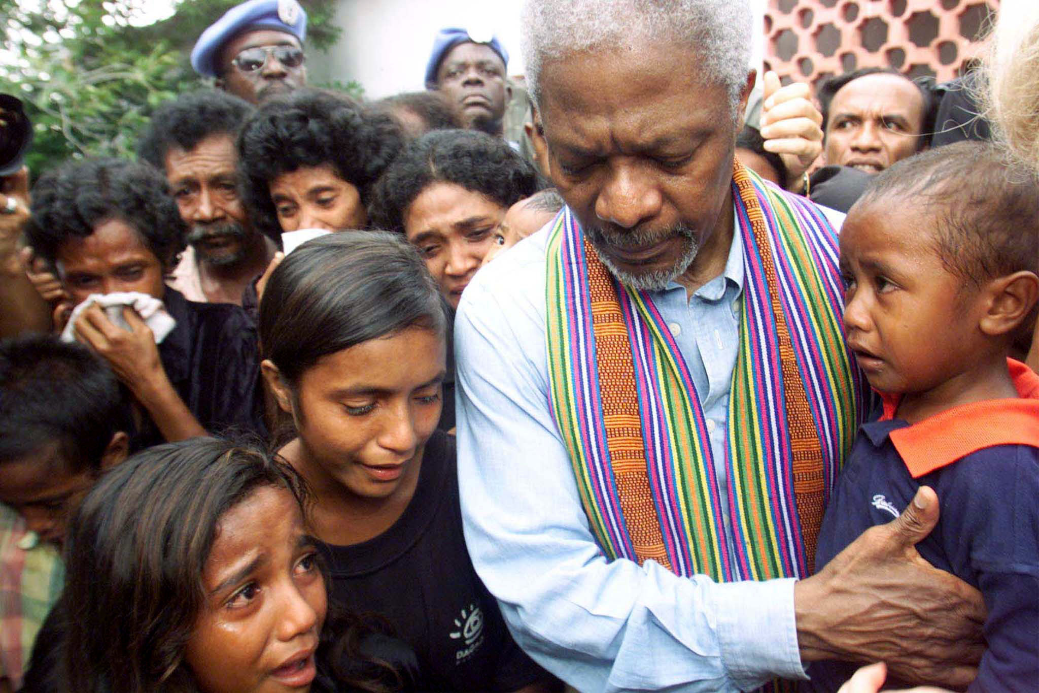 United Nations Secretary-General Kofi Annan consoles family members of victims of last April's massacre by pro-Indonesia militia in Liquisa, 30 km west of DIli February 17. At least 50 people were killed after pro-Indonesian militia and Indonesian soldiers attacked hundreds of refugees seeking shelter in a church compound. - PBEAHULNMCC