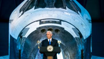 Vice President Mike Pence delivers opening remarks during the National Space Council's first meeting, Thursday, Oct. 5, 2017 at the Smithsonian National Air and Space Museum's Steven F. Udvar-Hazy Center in Chantilly, Va. The National Space Council, chaired by Pence, heard testimony from representatives from civil space, commercial space, and national security space industry representatives.