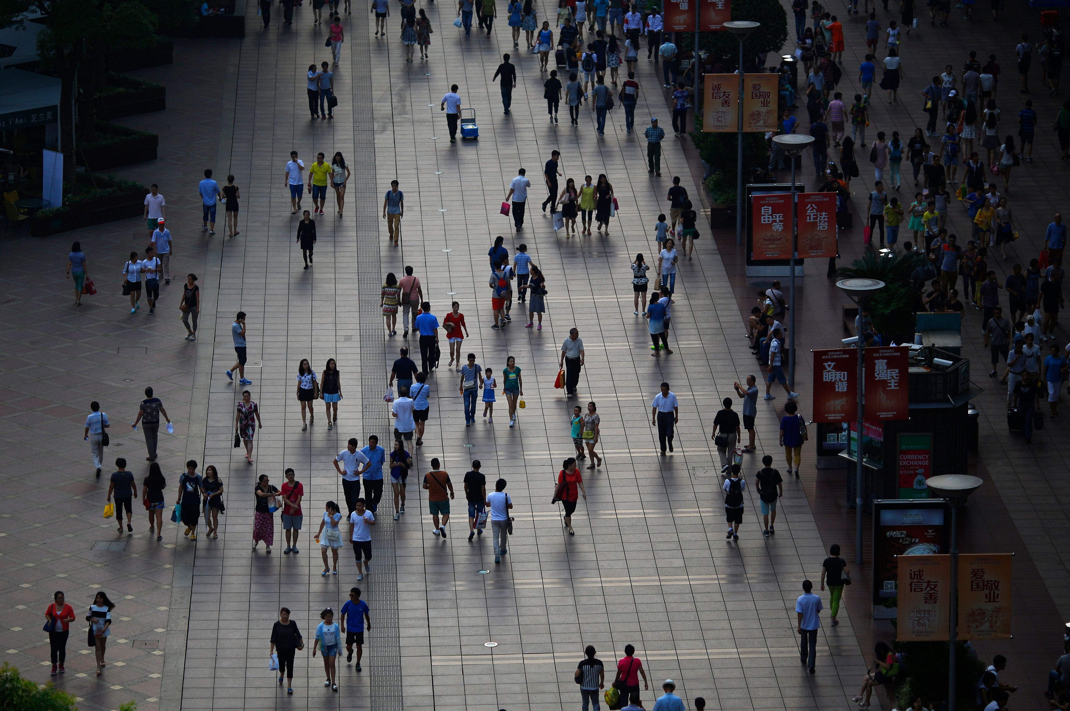 People walks along a pedestrian section of Nanjing road in downtown Shanghai
