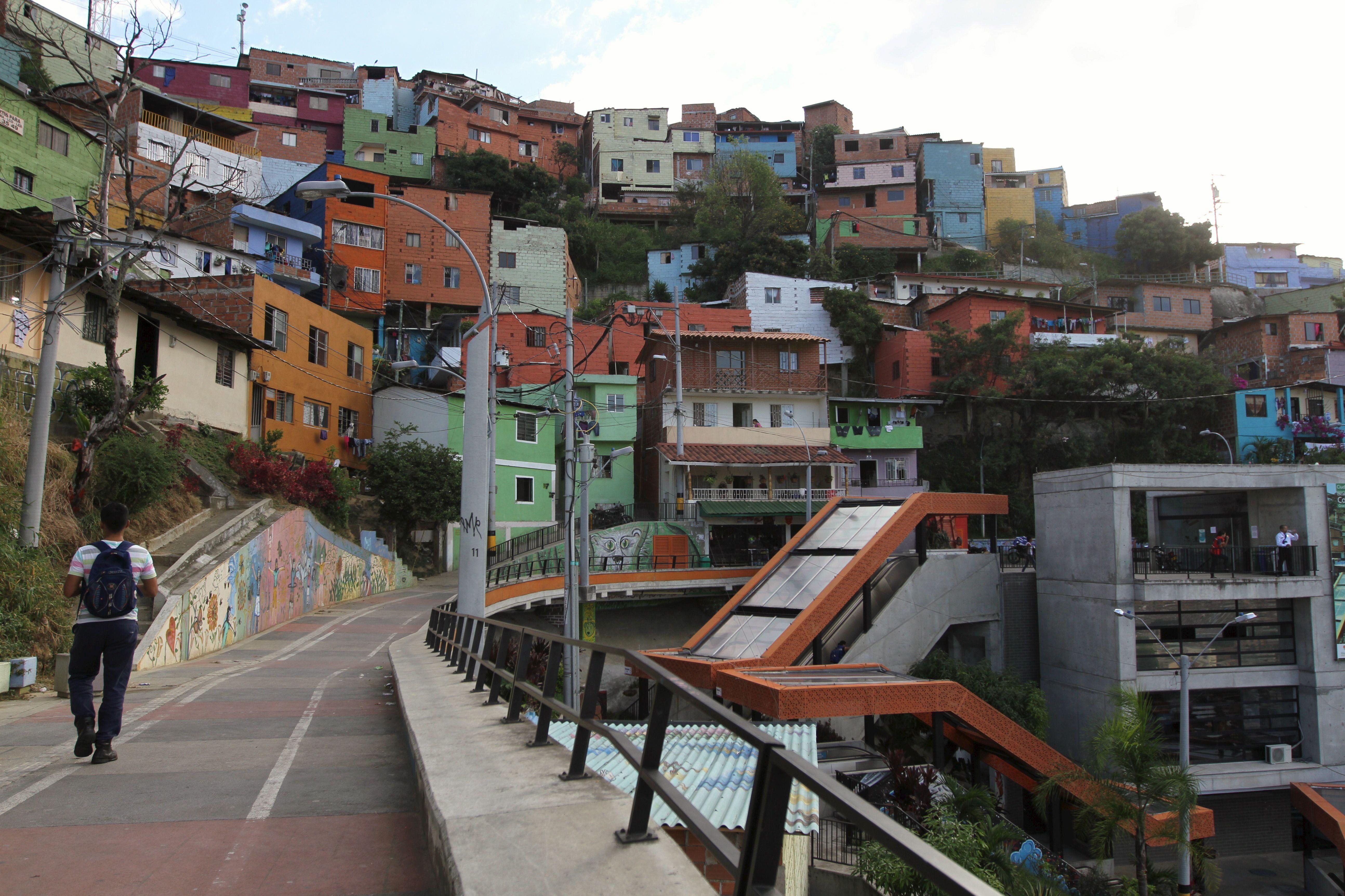 "A man walks in the ""Comuna 13"" neighborhood in Medellin"