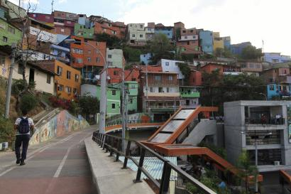 "A man walks in the ""Comuna 13"" neighborhood in Medellin"