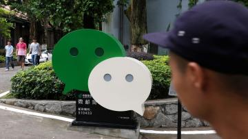 A WeChat logo is displayed inside TIT Creativity Industry Zone where Tencent office is located in Guangzhou, China May 9, 2017. Picture taken May 9, 2017. REUTERS/Bobby Yip - RC1C54083A80