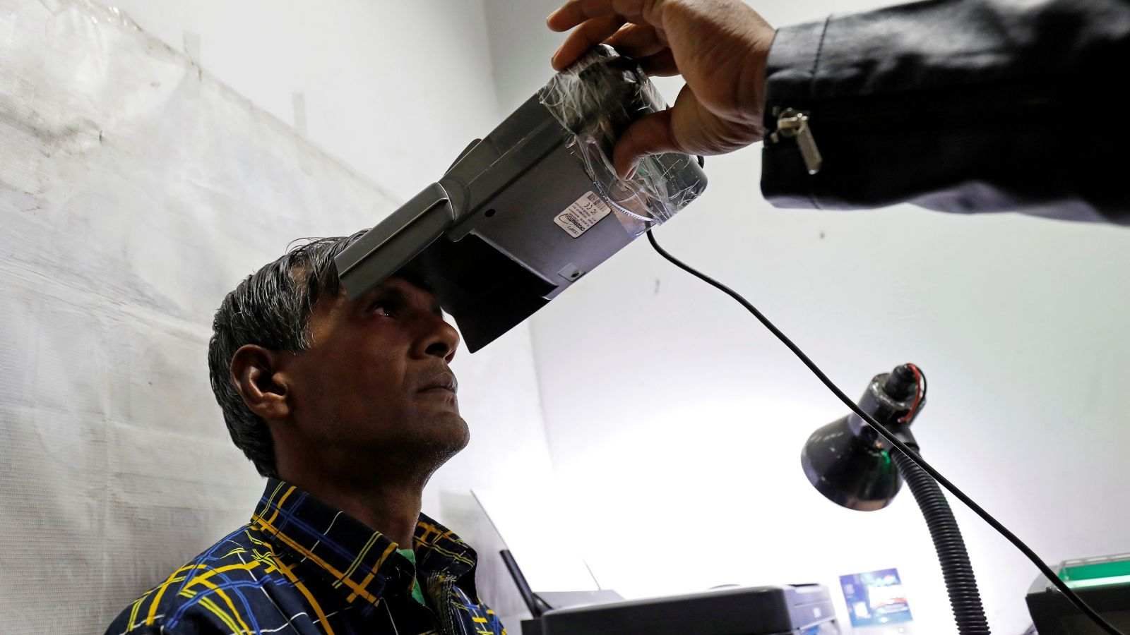 Aadhaar is voluntary—but millions of Indians are already trapped