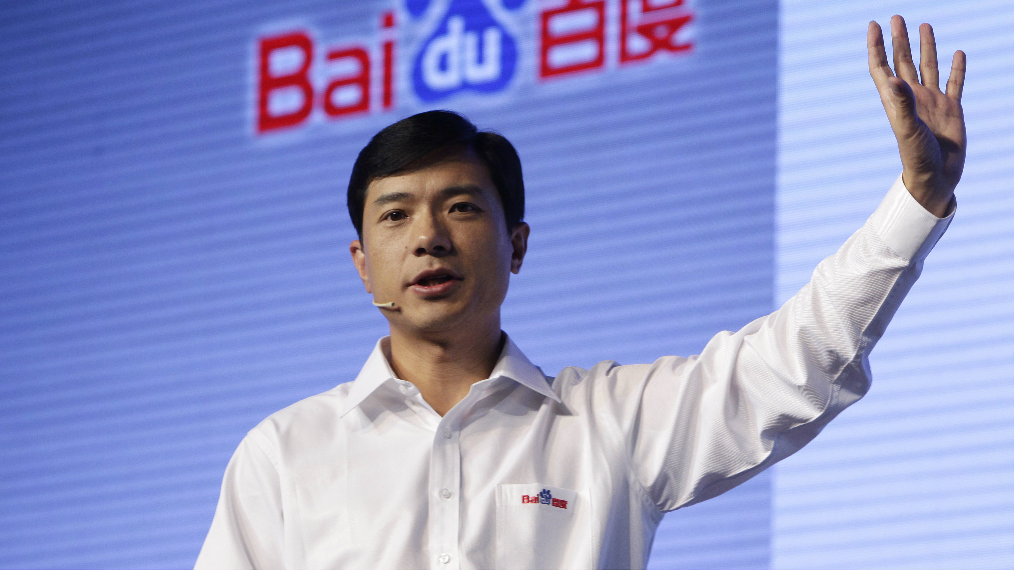 Robin Li, founder and chief executive of Chinese search engine Baidu, delivers a speech at the Baidu 2011 technology innovation conference in Beijing September 2, 2011. China's top search engine Baidu Inc launched a new mobile application system on Friday, seeking to bolster its presence in the mobile web as competitors including Alibaba Group increase their mobile offerings.