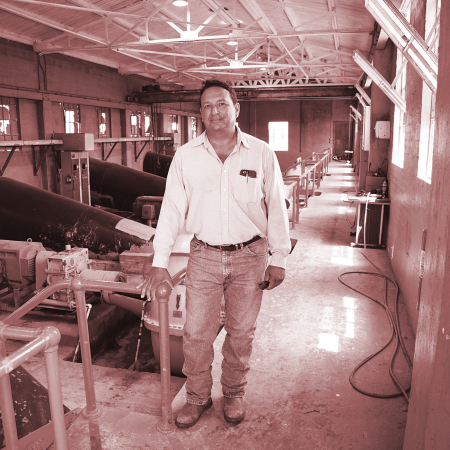 David Lozano, Operations Manager of the Delta Lake Irrigation District in Edcouch, Texas, standing in the district's pumphouse on the Rio Grande.