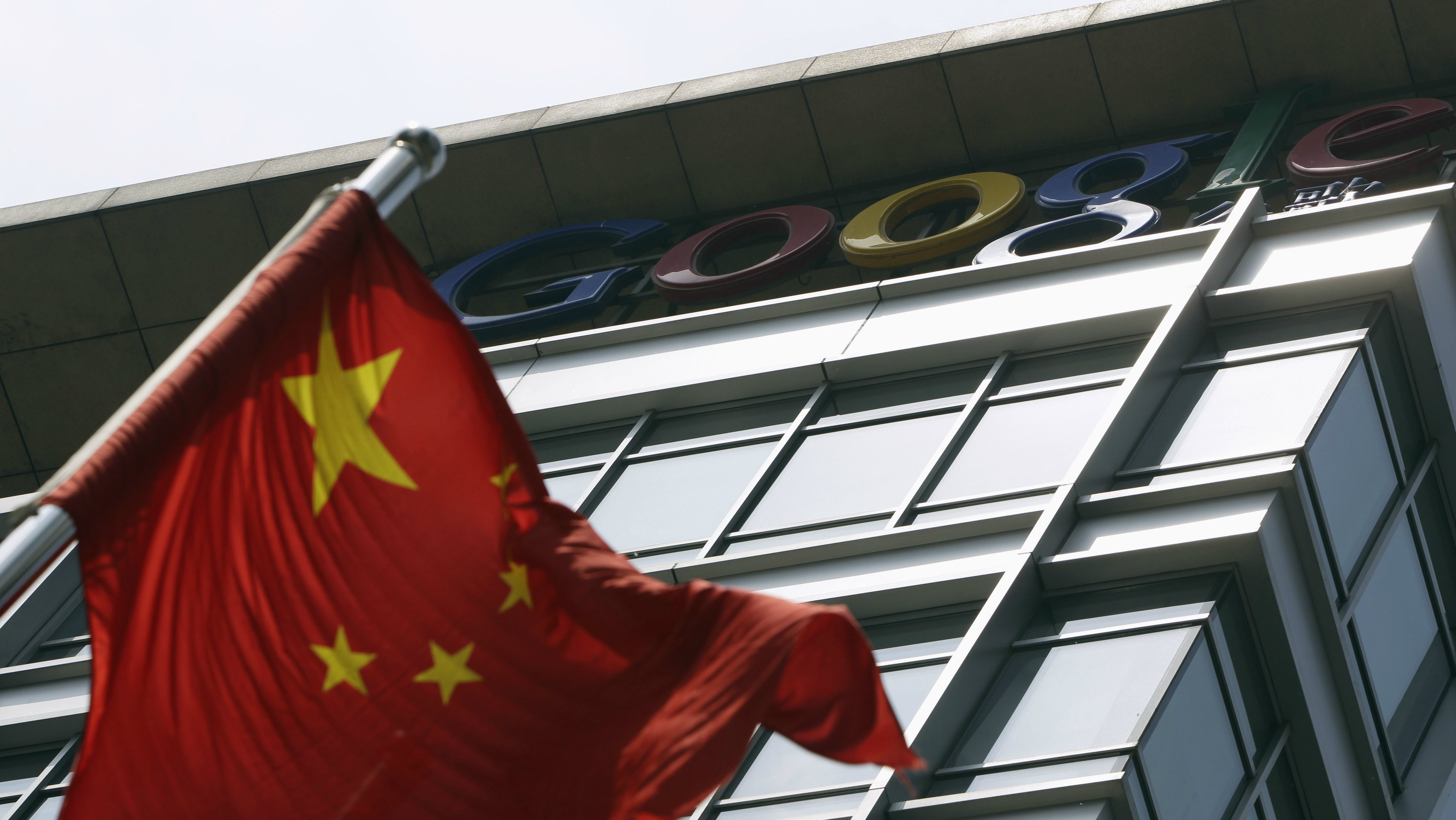 A Chinese national flag waves in front of the former headquarters of Google China in Beijing June 2, 2011. Suspected Chinese hackers tried to steal the passwords of hundreds of Google email account holders, including those of senior U.S. government officials, Chinese activists and journalists, the Internet company said.