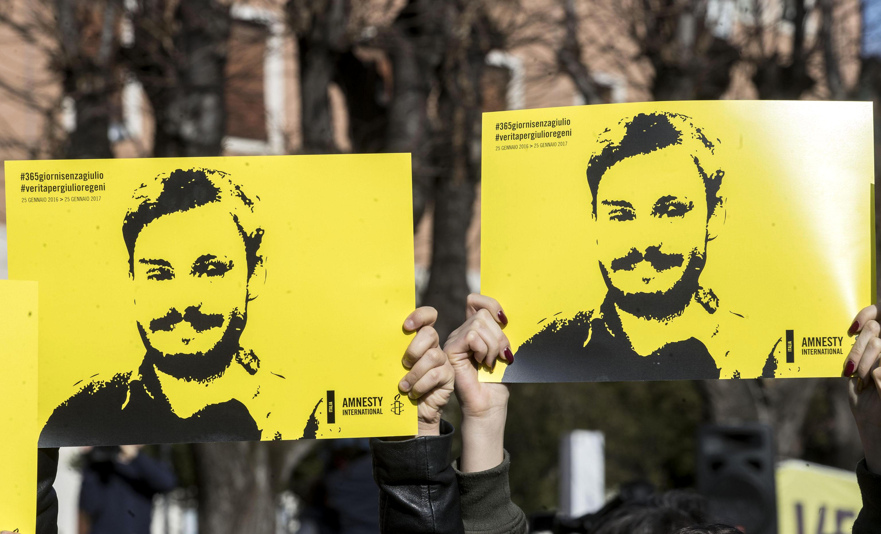 People hold signs depicting Giulio Regeni as they attend a march in memory of the Italian researcher at Sapienza University on the first anniversary of his disappearance in Egypt, Rome, Italy, 25 January 2017. Italian President Sergio Mattarella on the same day called for cooperation to bring the killers of Regeni in Egypt to justice. 'Italy has mourned the killing of one of its studious young people, Giulio Regeni, without full light being shed on this tragic case for a year, despite the intense efforts of our judiciary and our diplomacy', Mattarella said on the first anniversary of Regeni's disappearance. 'We call for broader and more effective cooperation so that the culprits are brought to justice'. Guilio Regeni was an Italian PhD student researching the independent trade unions in Egypt, he disappeared on 25 January 2016 in Cairo, then his body was found in a ditch on Cairo-Alexandria road outside of Cairo on 03 February 2016 with signs of torture.