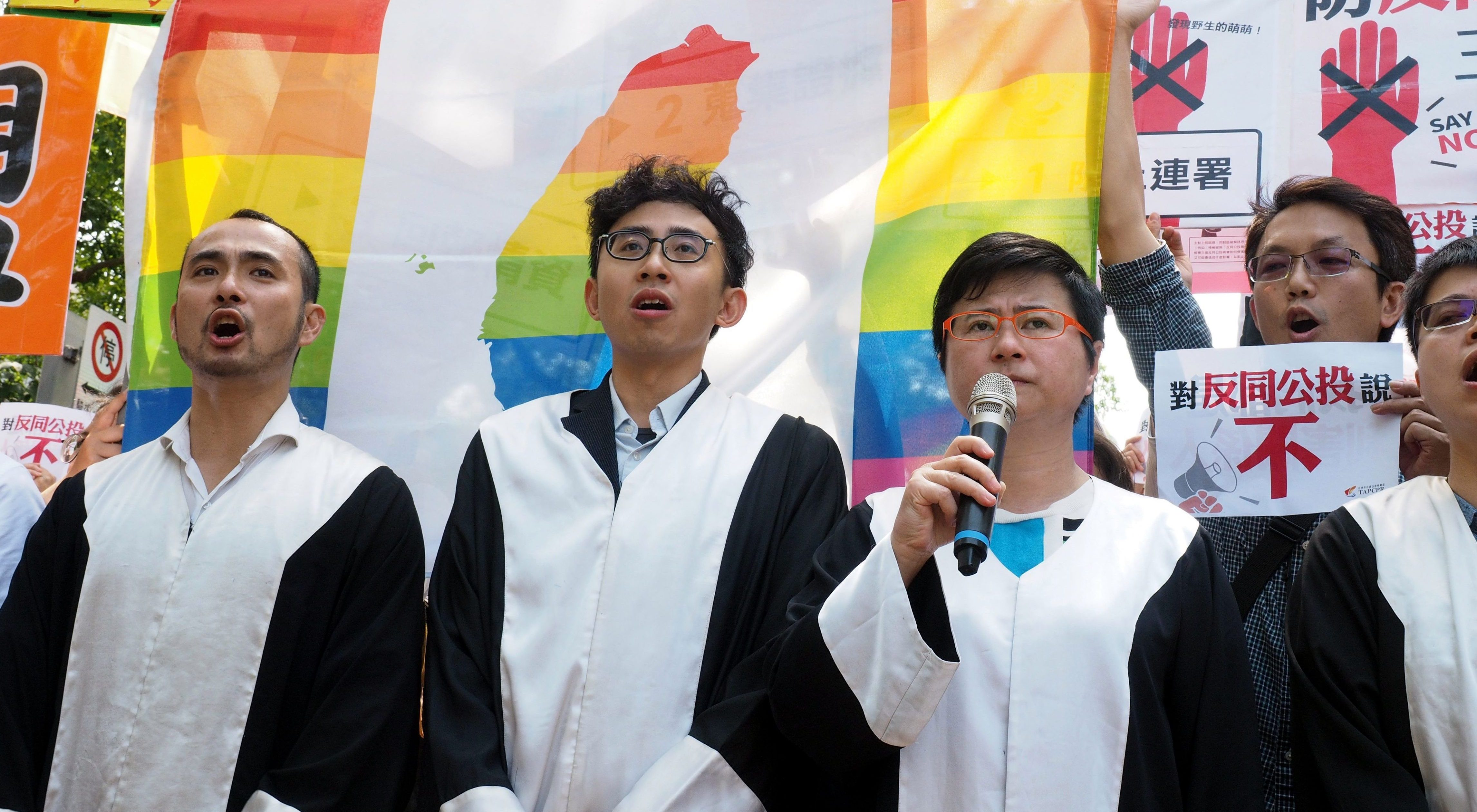 Taiwan gay rights groups protest referendums aimed at same-sex marriage.