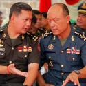 General Sao Sokha (2-R), Commander of the National Gendarmerie, talks with Lieutenant General Hun Manet (2-L), at a ceremony in Phnom Penh, Cambodia, 30 June 2018. General Sao Sokha, Commander of the National Gendarmerie, and Lieutenant General Hun Manet, the Deputy Commander of Army of the Royal Cambodian Armed Forces (RCAF) were transferred in key acting positions at the Ministry of National Defense.