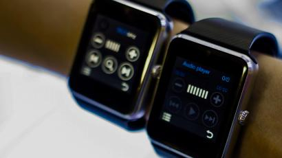 Wrist with two Apple watches.