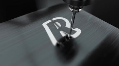 A machine tool etches information onto a Revolut payment card