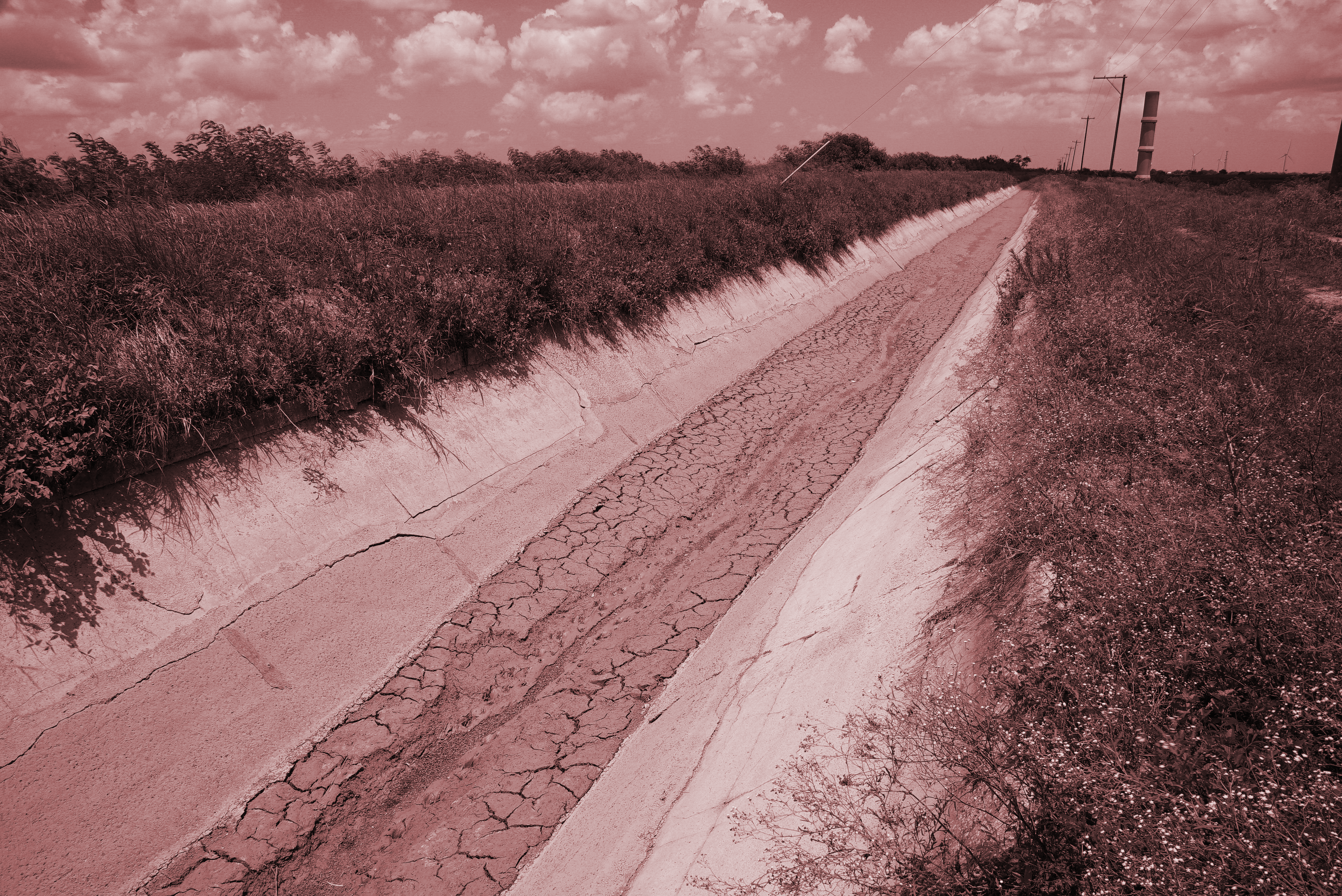 Earthen canals like the one pictured above near Raymondville, Texas, leak like a sieve, losing much of the water they carry before reaching their destinations.