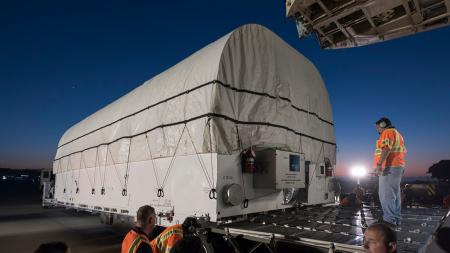Loading the satellite container onto the C-5 Galaxy.