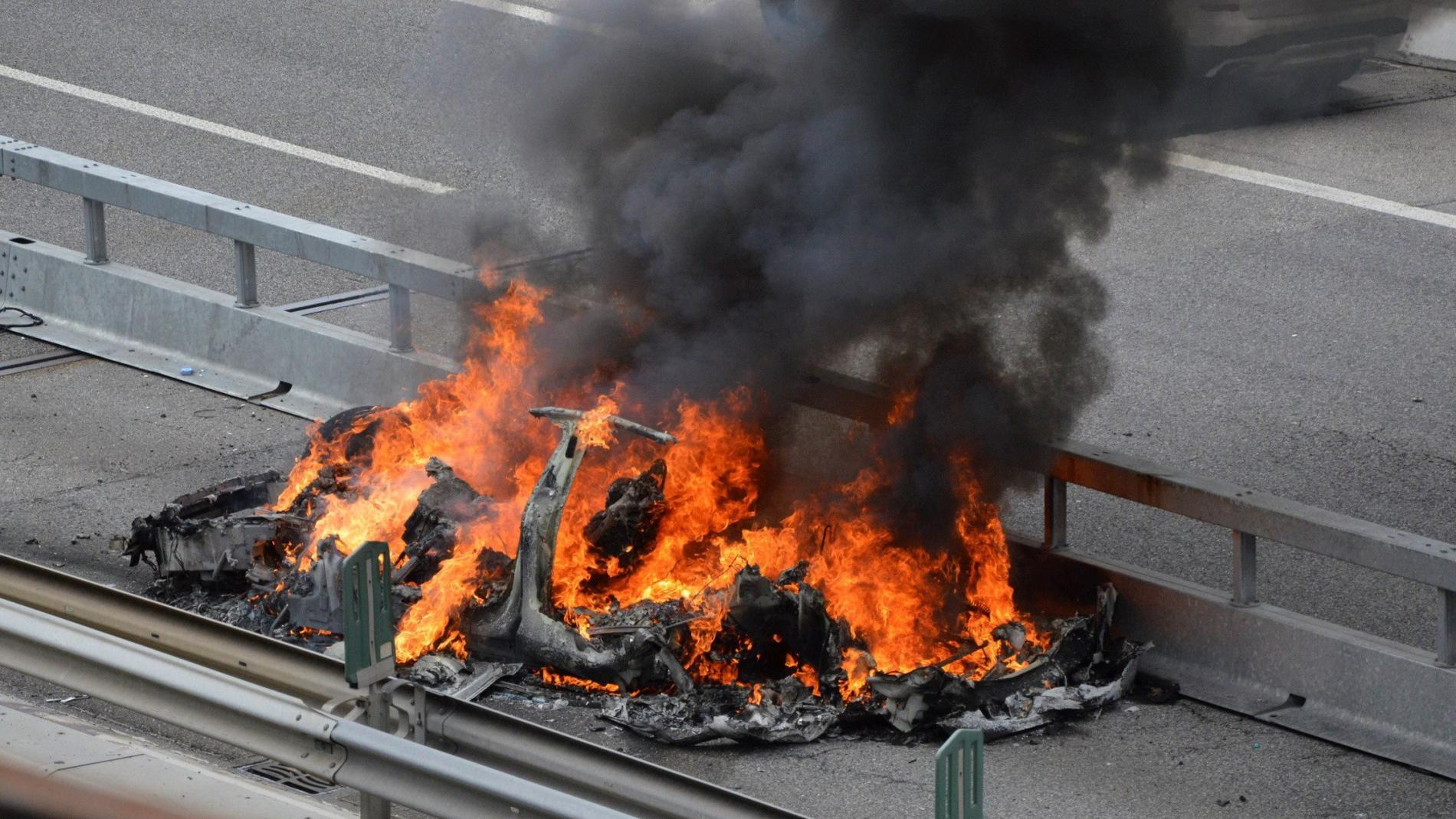 An electric-powered Tesla car burns after a crash on the Swiss A2 motorway on Monte Ceneri near Bellinzona, Switzerland May 10, 2018. Picture taken on May 10, 2018.