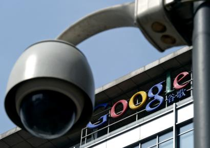 FILE - In this March 23, 2010 file photo, a surveillance camera is seen in front of the Google China headquarters in Beijing, China. Connections to Google Inc.'s popular email service have been blocked in China amid efforts by the government to limit access to the company's services. Records from Google's Transparency Report show online traffic from China to Gmail dropped to zero on Saturday, Dec. 27 although there was a small pickup on Monday, Dec. 29, 2014. (AP Photo/Andy Wong, File)