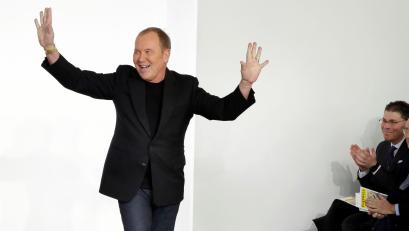 Designer Michael Kors acknowledges audience applause after his collection was modeled during Fashion Week in New York, Wednesday, Feb. 14, 2018. (AP Photo/Richard Drew)