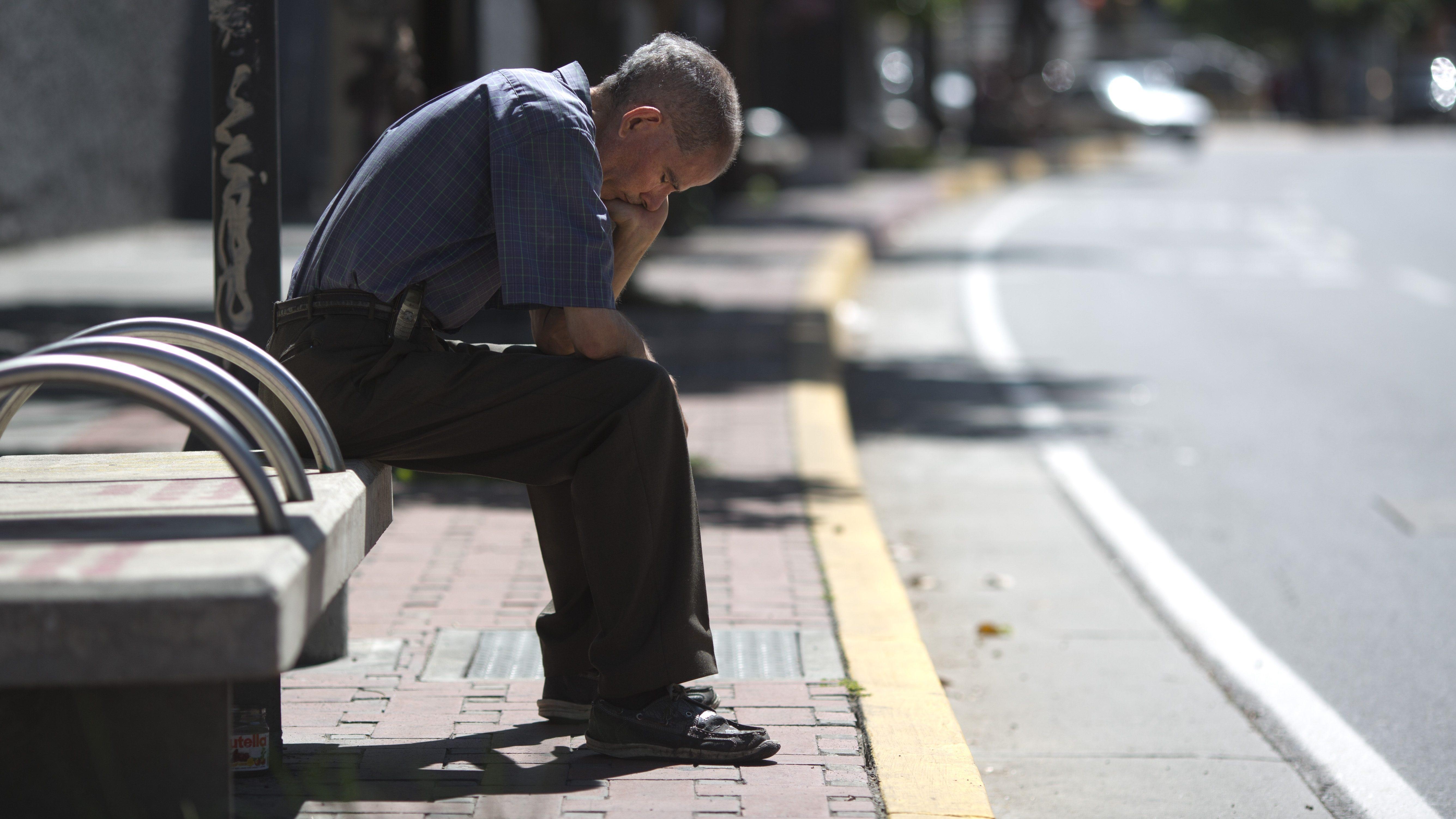 A man sits on a bench in Caracas, Venezuela, Monday, Aug. 20, 2018.