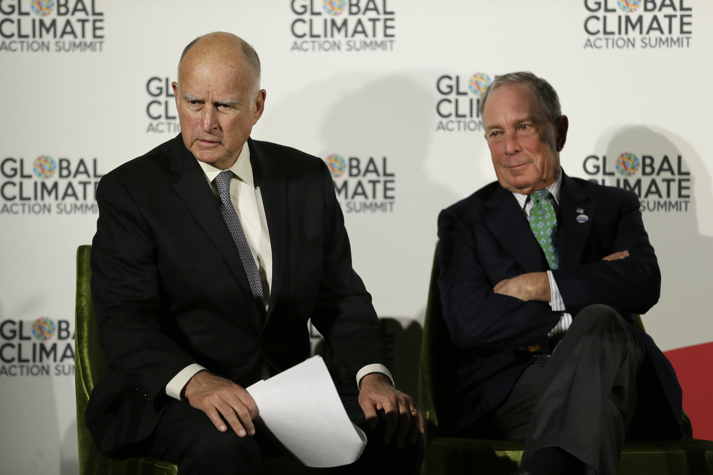 California Gov. Jerry Brown, left, and Michael Bloomberg listen to questions during a news conference at the Global Action Climate Summit Thursday, Sept. 13, 2018, in San Francisco. Gov. Brown started his global climate summit by saying that President Donald Trump will likely be remembered as a liar and fool when it comes to the environment. The Democratic Brown and former New York City Mayor Michael Bloomberg held a press conference Thursday on the first full day of the summit that is partly a rebuke of the Trump administration. (AP Photo/Eric Risberg)