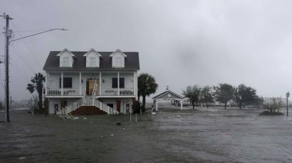High winds and water surround a house as Hurricane Florence hits Swansboro N.C., Friday, Sept. 14, 2018. (AP Photo/Tom Copeland)