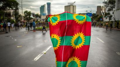 A man holds an Oromo Liberation Front (OLF) flag as hundreds of thousands of Ethiopians gathered to welcome returning leaders of the once-banned group in the capital Addis Ababa, Ethiopia Saturday, Sept. 15, 2018. The OLF and two other organizations were removed from a list of terror groups earlier this year after Prime Minister Abiy Ahmed took office, amid sweeping reforms to bring opposition groups back to politics.
