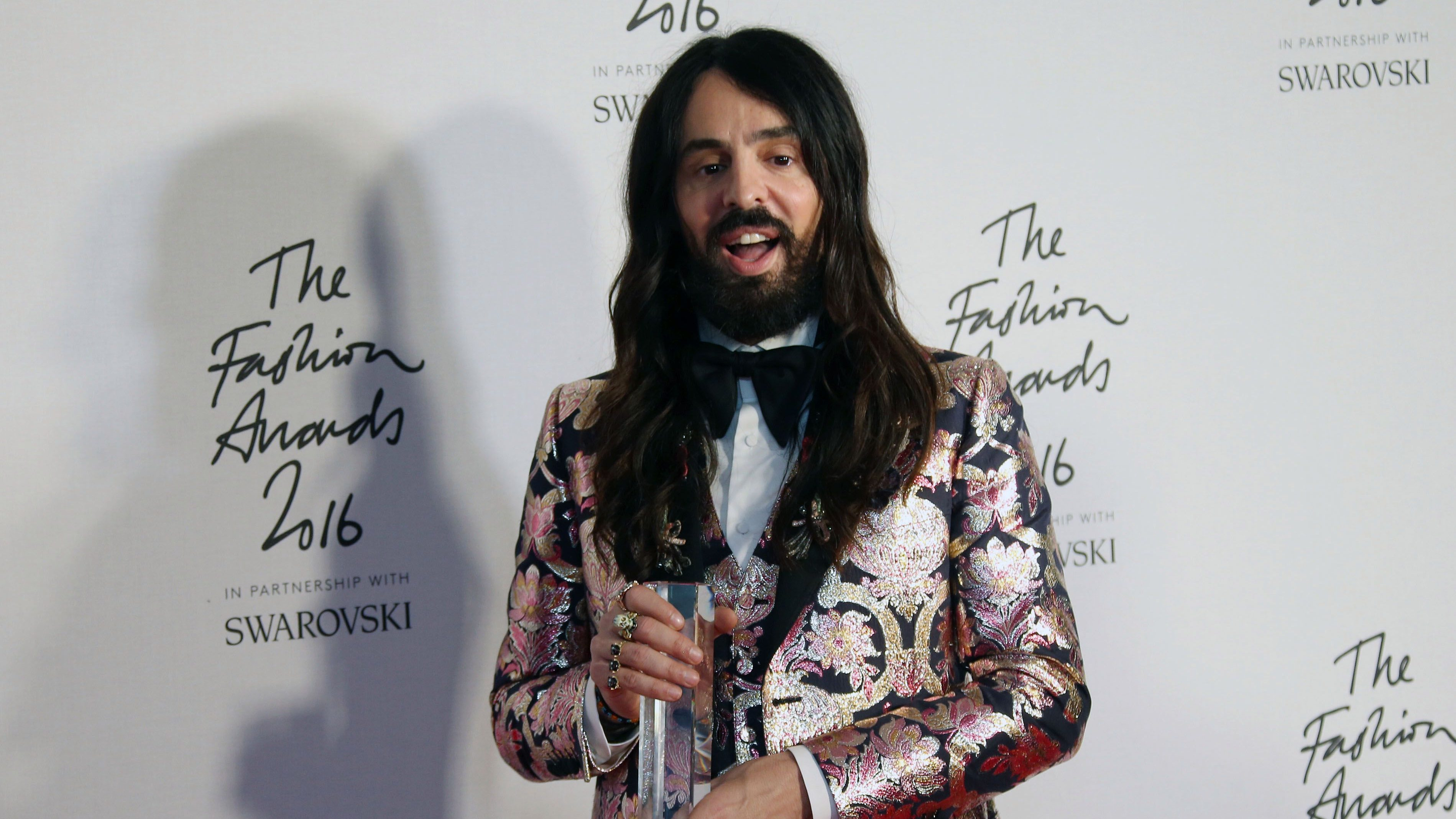 4a5bb5ef5016 Designer Alessandro Michele poses in the winners room after winning the  International Accessories Designer Award at