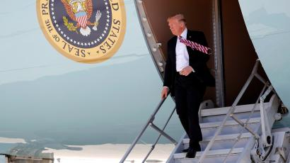 President Donald Trump walks downthe stairs during his arrival on Air Force One at Miami International Airport, Monday, April 16, 2018, in Miami. Trump traveled to Florida to promote his $1.5 trillion tax cut package he signed into law.