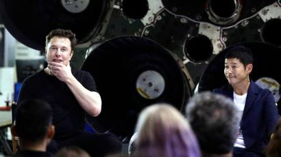 SpaceX founder and chief executive Elon Musk, left, speaks after announcing Japanese billionaire Yusaku Maezawa, right, as the first private passenger on a trip around the moon, Monday, Sept. 17, 2018, in Hawthorne, Calif.