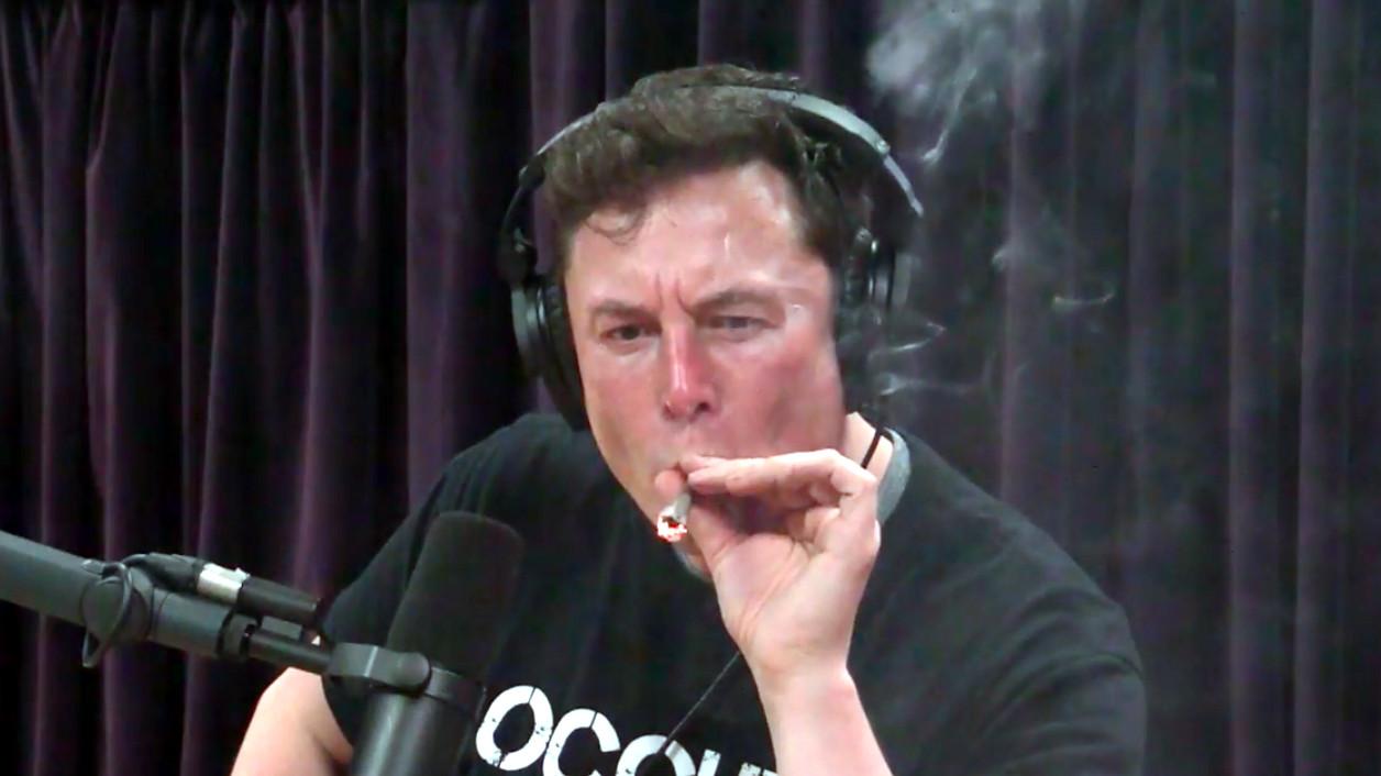 Elon Musk smokes a blunt during an interview with Joe Rogan.