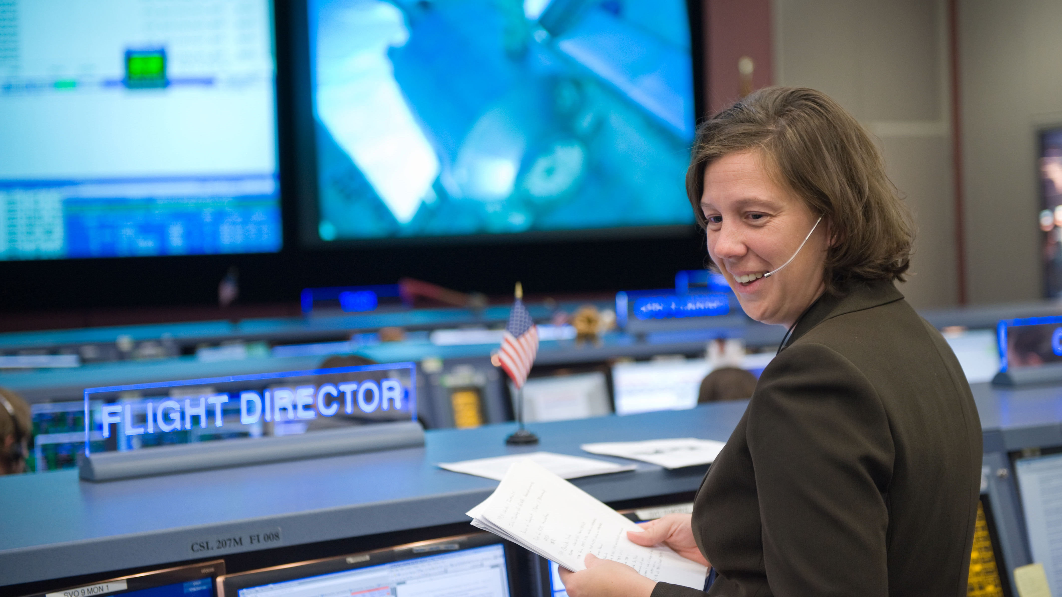 Ridings in 2008 as a flight controller on a space shuttle mission.