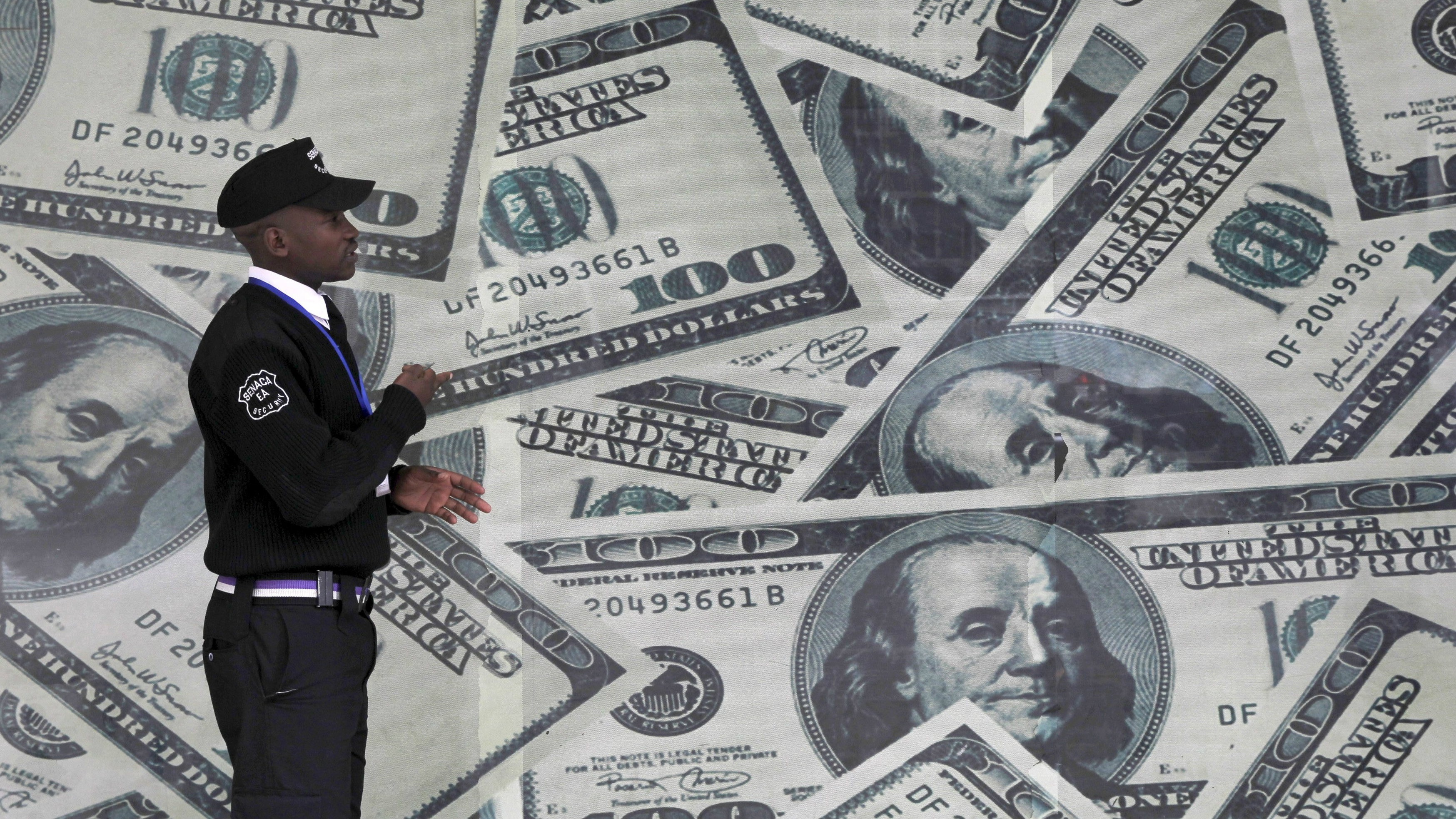 A Man In Front Of Wall Pictures Hundred Dollar Bills