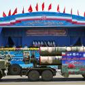 In front of the portraits of supreme leader Ayatollah Ali Khamenei, right, and late revolutionary founder Ayatollah Khomeini, left, a long-range, S-300 missile system is displayed by Iran's army during a military parade marking the 36th anniversary of Iraq's 1980 invasion of Iran, in front of the shrine of late revolutionary founder Ayatollah Khomeini, just outside Tehran, Iran, Wednesday, Sept. 21, 2016.