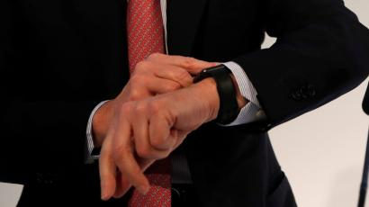 An executive looks at his watch