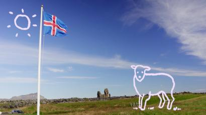 A cartoon sheep and sun on an image of the Icelandic flag in rural Iceland.