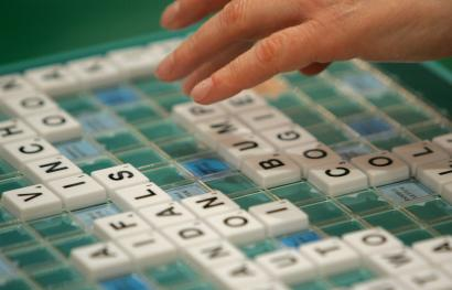 A competitor takes part in the World Scrabble Championships in London.