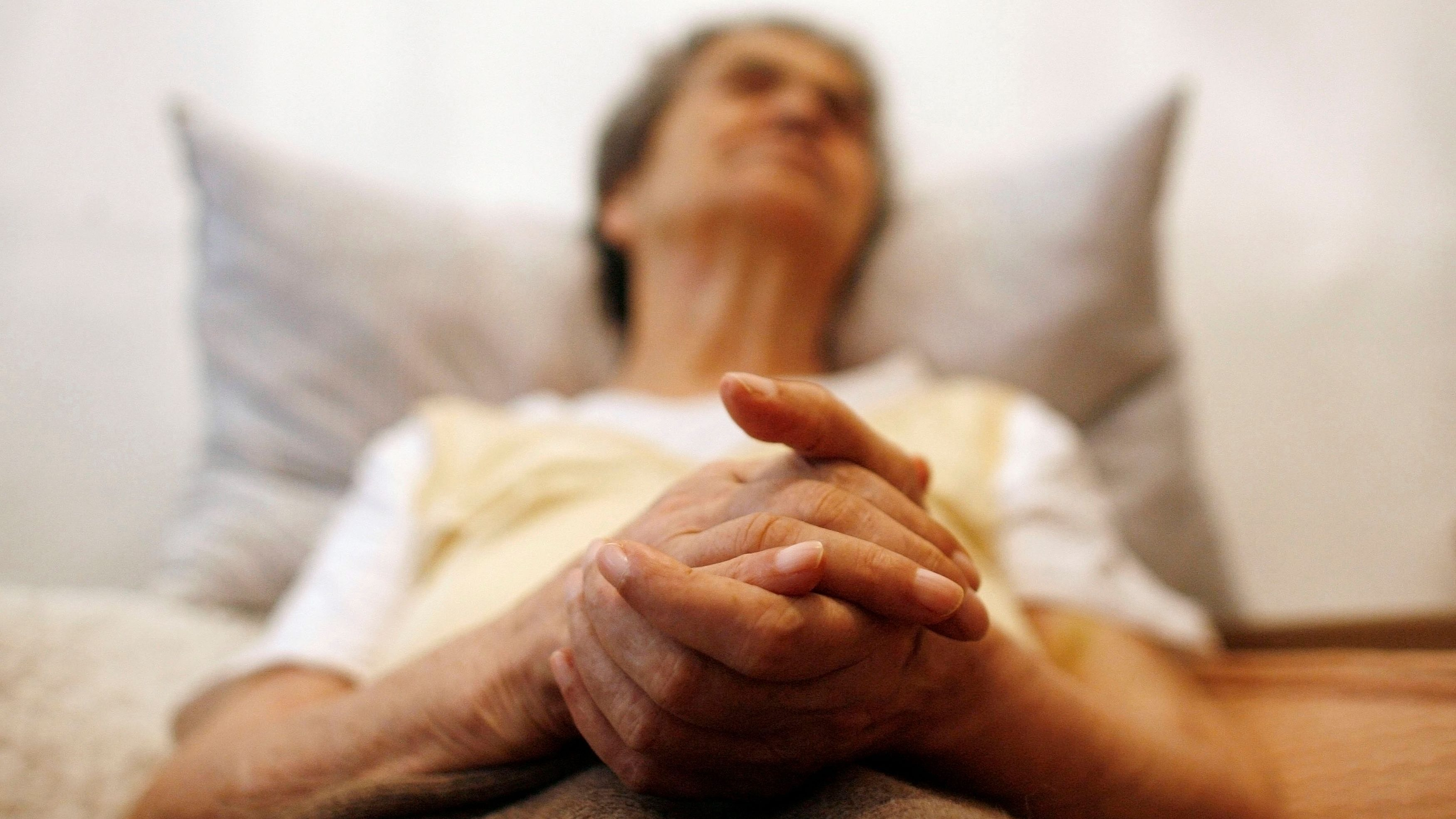 A person with dementia related to Alzheimer's laying in bed