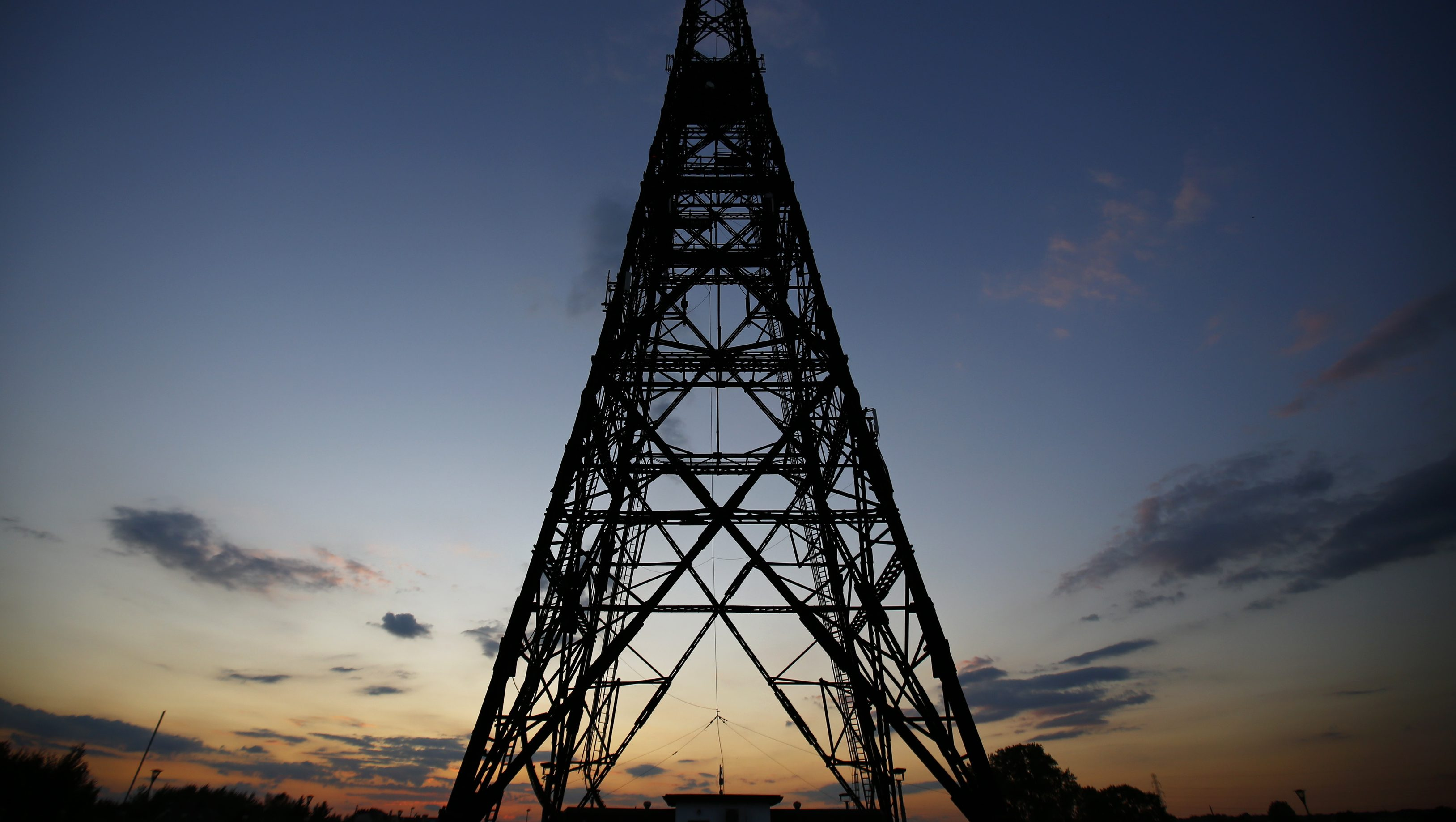 Gliwice radio tower, Europe's tallest wooden structure, is pictured after sunset at Gliwice radio station in Upper Silesia, southern Poland, August 28, 2014. As Poles and Germans prepare to mark the 75th anniversary on Monday of Hitler's invasion of Poland, historians and residents of Gliwice recalled the seizure of the radio station - still today Europe's tallest wooden structure - and drew parallels with the role of media in modern conflicts such as Ukraine. Picture taken on August 28, 2014. REUTERS/Kacper Pempel (POLAND - Tags: CONFLICT ANNIVERSARY) - GM1EA8U04TF01