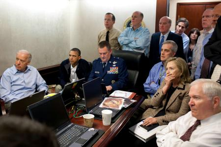 President Obama and Vice President Biden, along with members of the national security team, receive an update on the mission against bin Laden in the Situation Room of the White House