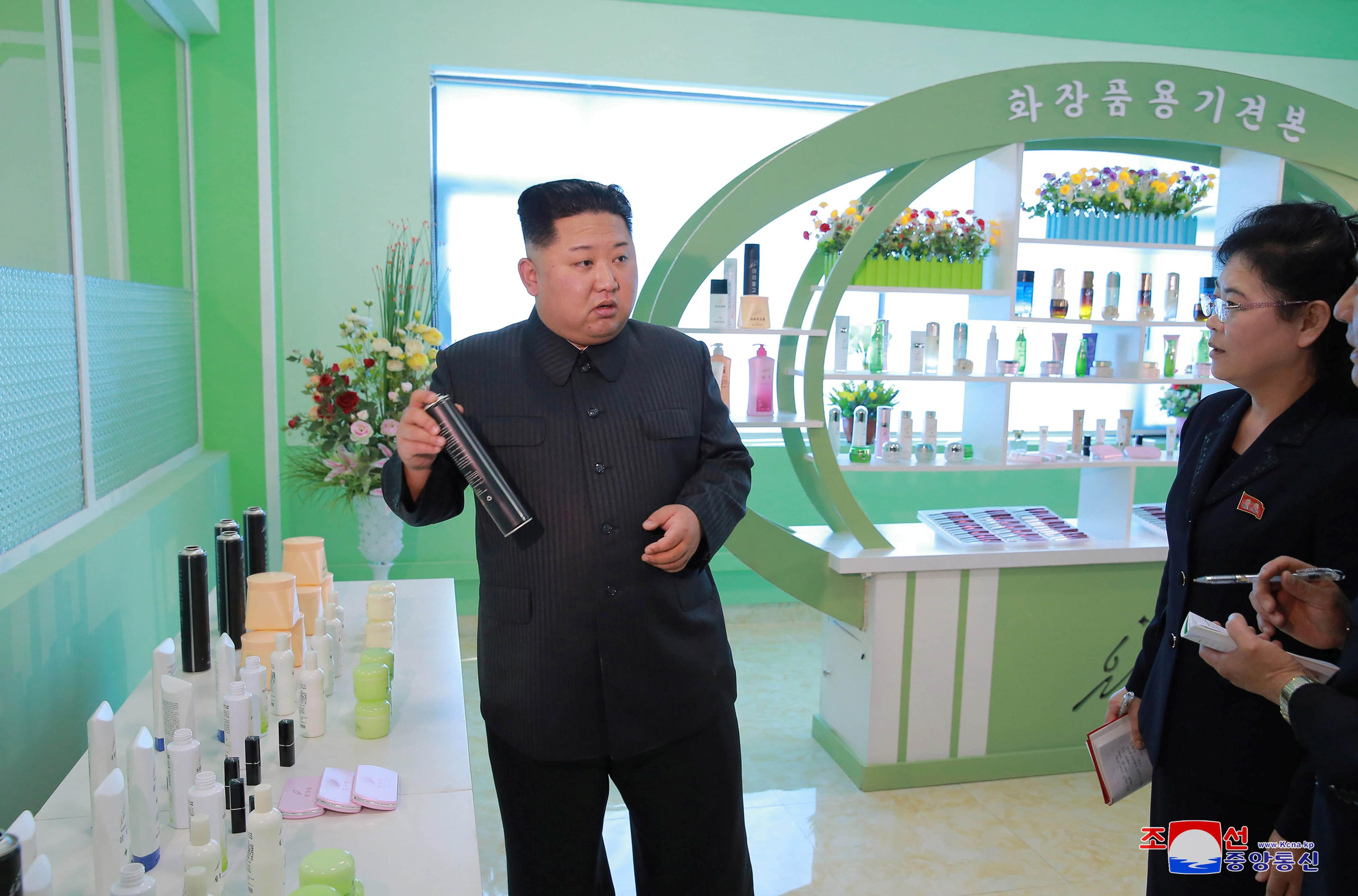 Kim Jong Un at the Pyongyang Cosmetics Factory in 2017.