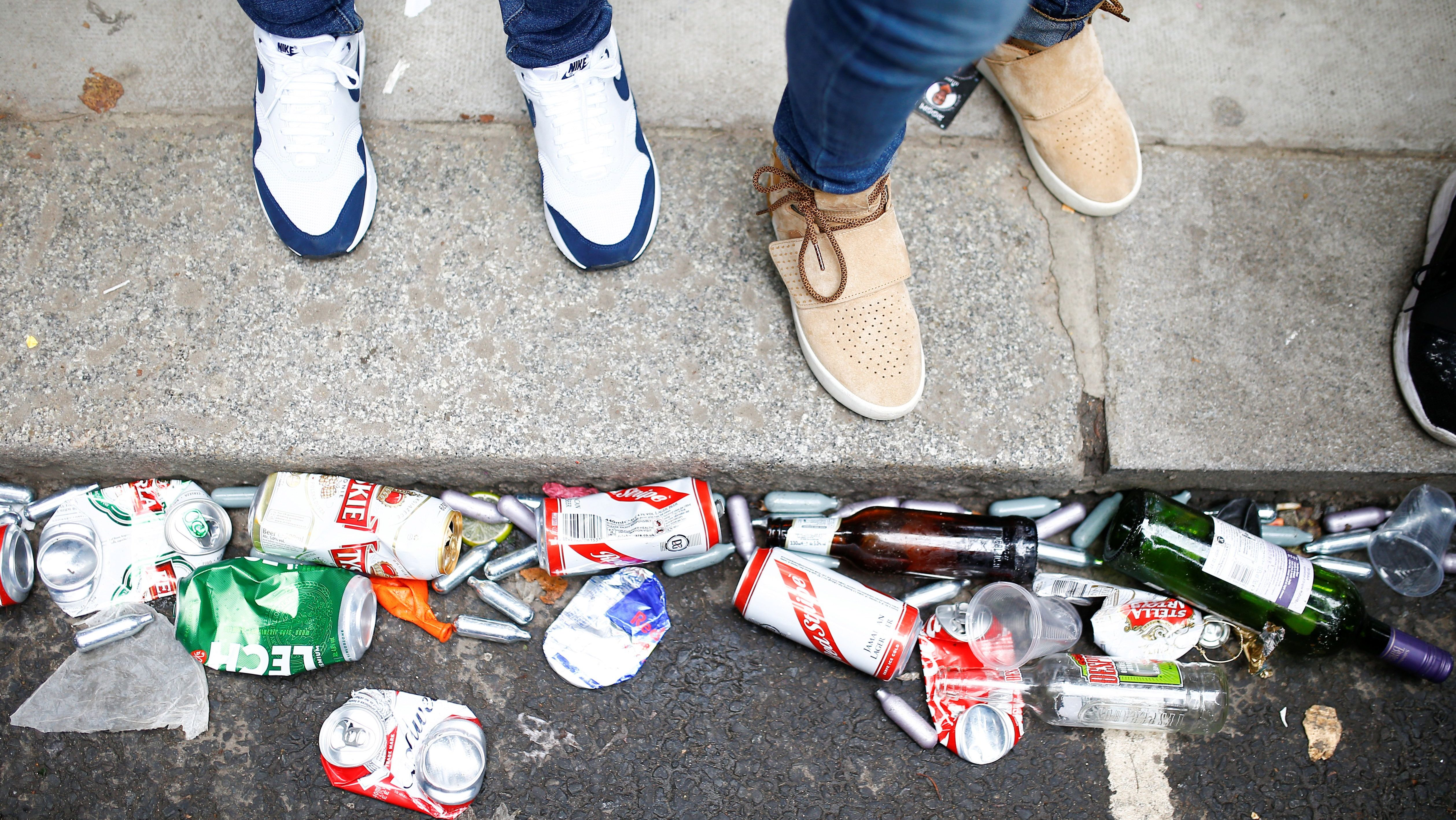 Empty canisters and beer cans can be seen on the ground during the Notting Hill Carnival in London.