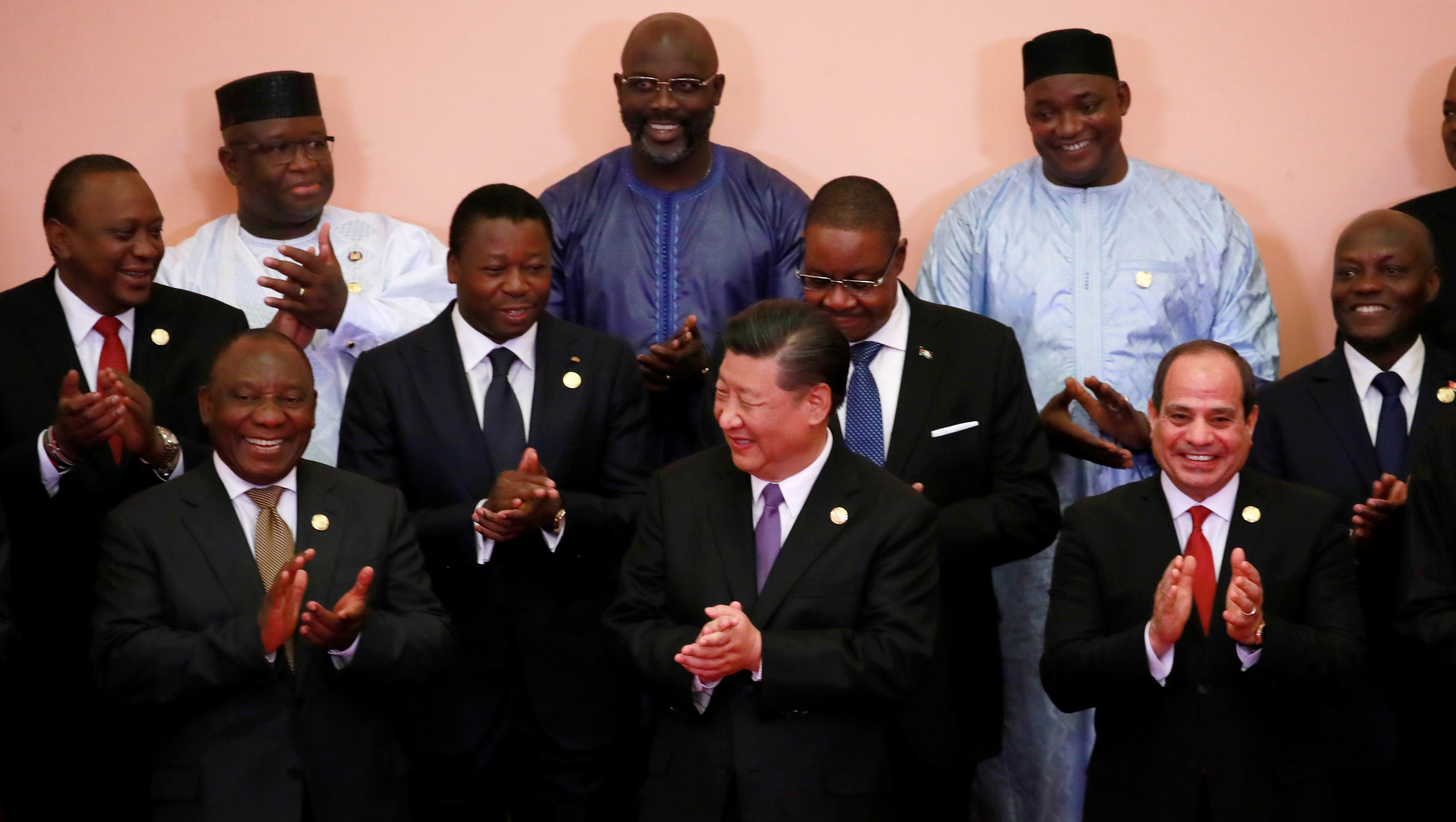 Chinese President Xi Jinping (front C), South African President Cyril Ramaphosa (front 3-L), Egyptian President Abdel Fattah al-Sisi (front L), KenyaÕs President Uhuru Kenyatta (2nd row L), TogoÕs President Faure GnassingbŽ (2nd row 2-L), Malawi's President Arthur Peter Mutharika (2nd row C), Guinea-Bissau's President Jose Mario Vaz (2nd row R), Sierra Leone President Julius Maada Bio (last row L), Liberian President George Weah (last row C) and other African leadersclap during a group photo session during the Forum on China-Africa Cooperation (FOCAC) 2018 Beijing Summit in Beijing, China, September 3, 2018. How Hwee Young/POOL Via REUTERS - RC1D22627100