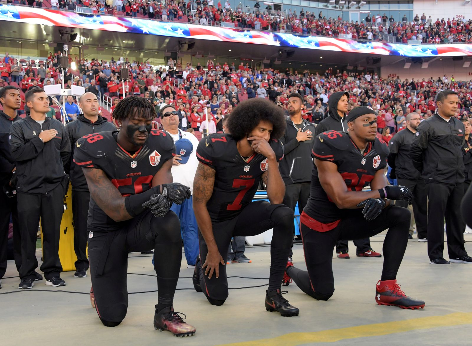 FILE PHOTO: San Francisco 49ers outside linebacker Eli Harold (58), quarterback Colin Kaepernick (7) and free safety Eric Reid (35) kneel in protest during the playing of the national anthem before a NFL game against the Arizona Cardinals in Santa Clara, California, Oct 6, 2016. Mandatory Credit: Kirby Lee-USA TODAY Sports/File Photo - RC15D997F5B0
