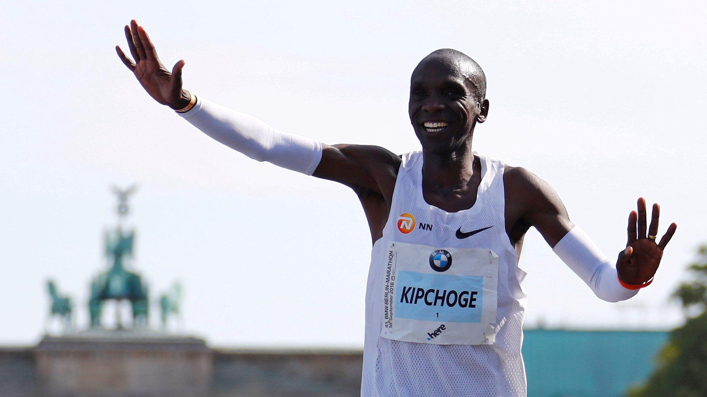 Eliud Kipchoge celebrates after winning the Berlin marathon.