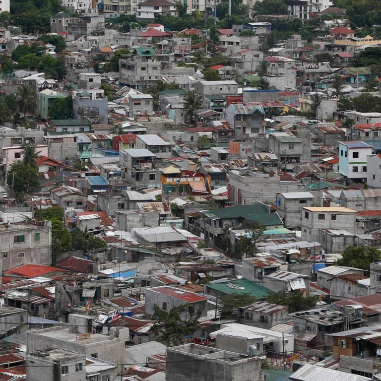 A poor residential district and squatter colonies are overlooked by high rise residential and commercial buildings in Taguig, Metro Manila.