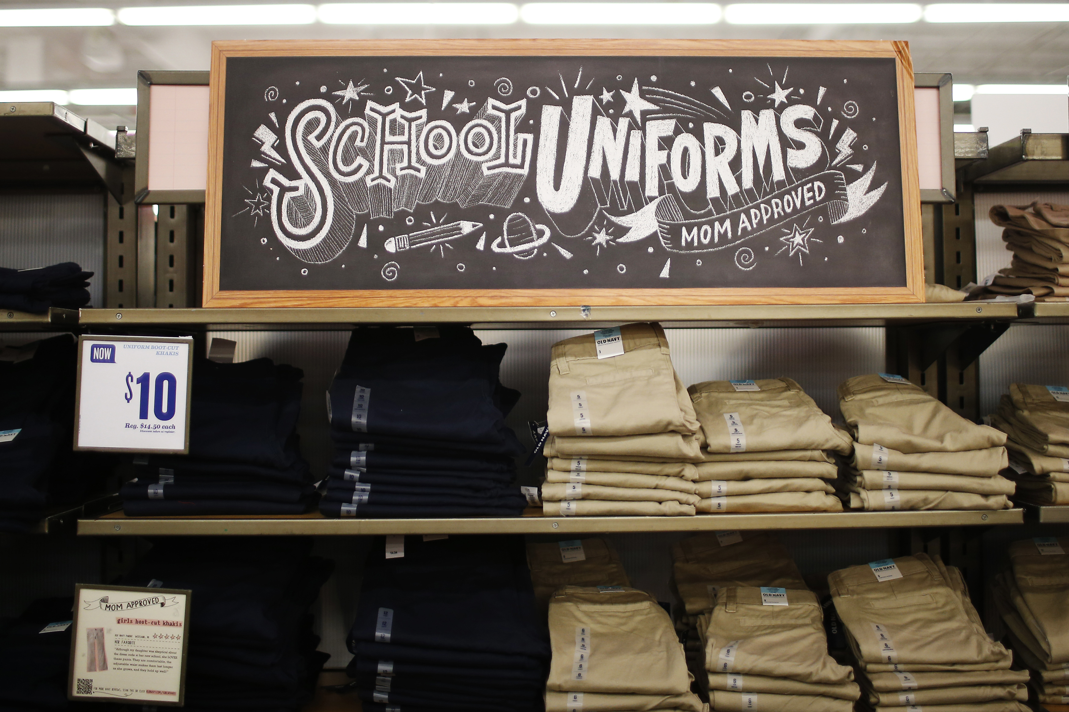 """A stack of school uniforms are seen on the shelves inside the Old Navy clothing shop during a """"ChildSpree"""" back-to-school shopping event in San Jose, August 3, 2013. The event, hosted annually by the Salvation Army, provides 100 children in need of economic assistance, $100 each to shop for new clothes in preparation for the upcoming school year, according to a representative from the organization. REUTERS/Stephen Lam (UNITED STATES - Tags: BUSINESS EDUCATION SOCIETY) - GM1E984056J01"""