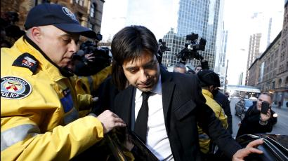 Jian Ghomeshi (C), a former celebrity radio host who has been charged with multiple counts of sexual assault, leaves the courthouse after the first day of his trial in Toronto, February 1, 2016.