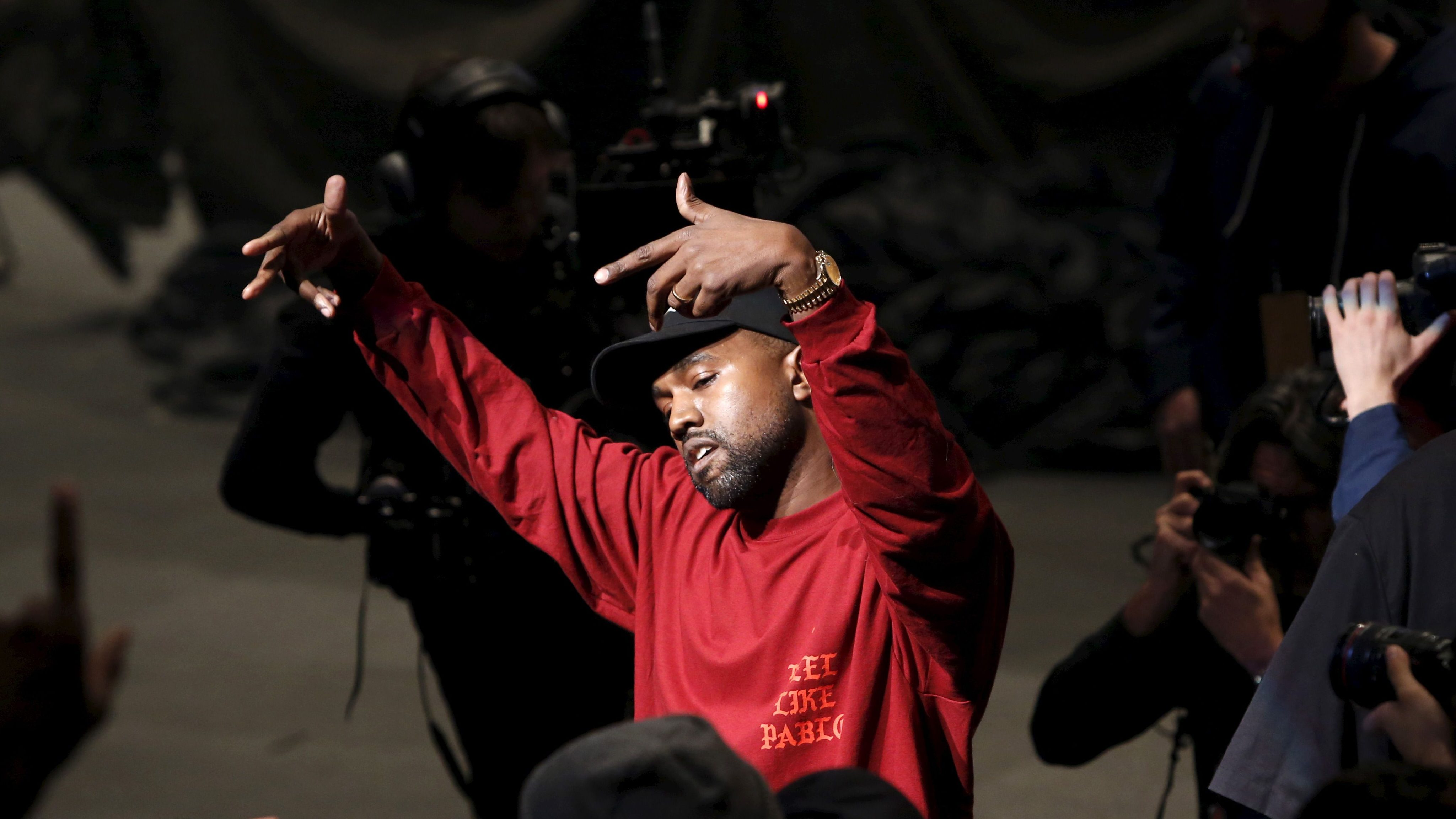 Kanye West dances during his Yeezy Season 3 Collection presentation and listening party for the